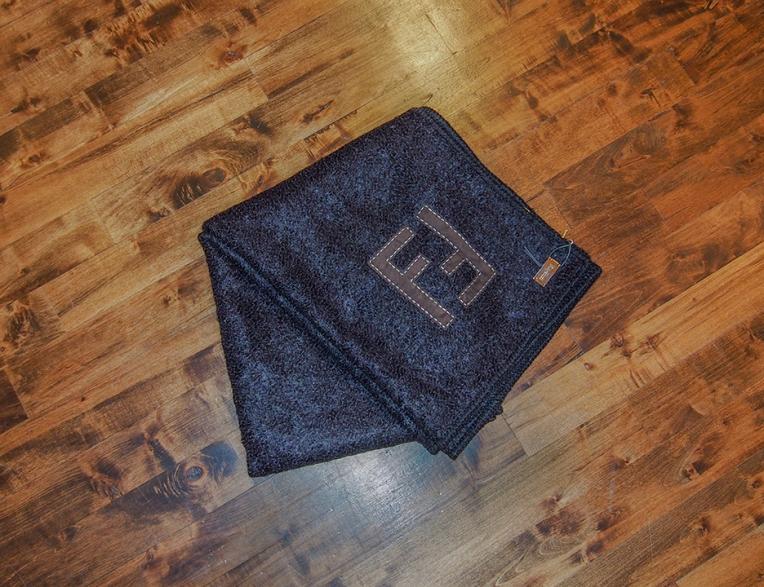 Fendi Casa  Mohair wool with almara leather Fendi insignia using selleria stitching.